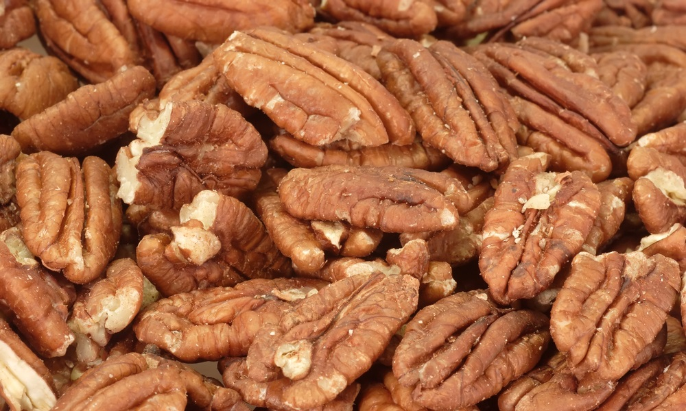 Pecan nuts in detail as background.