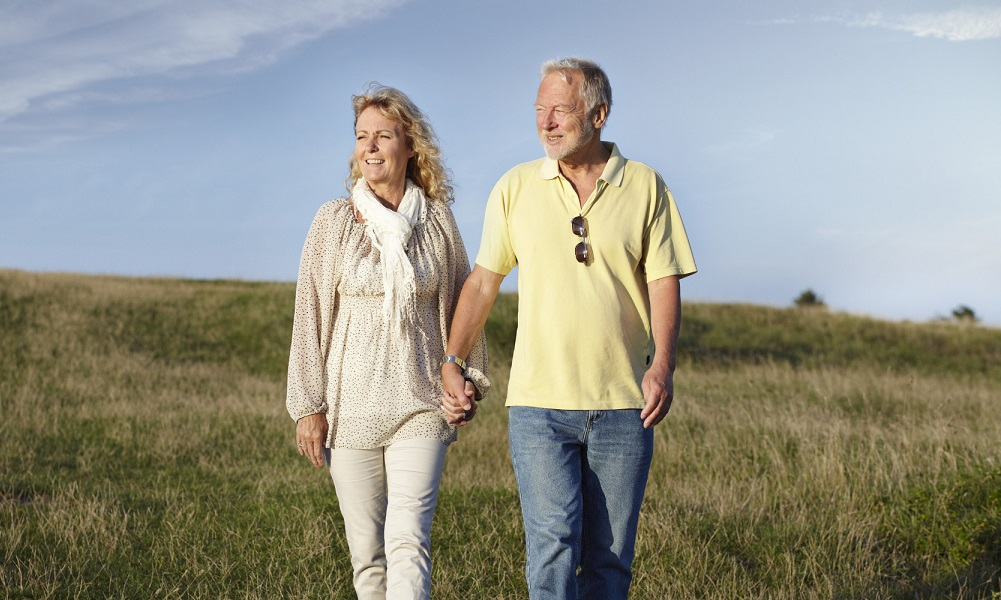 Mature couple walking in the nature