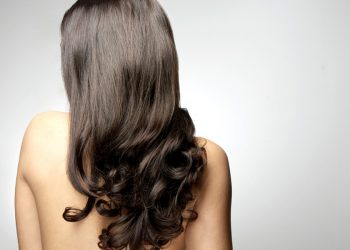 Healthy womans hair back view isolated in studio shot; Shutterstock ID 407657407; PO: today.com